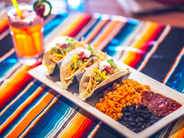 tacos served on the table together with mocktail drink