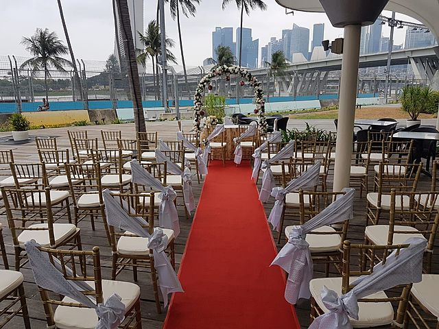 decoration for outdoor solemnisation with red aisle