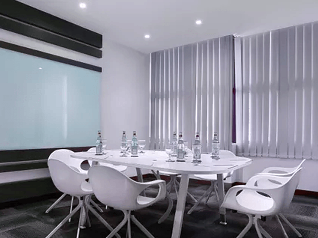 small meeting room with board with white dominant colour