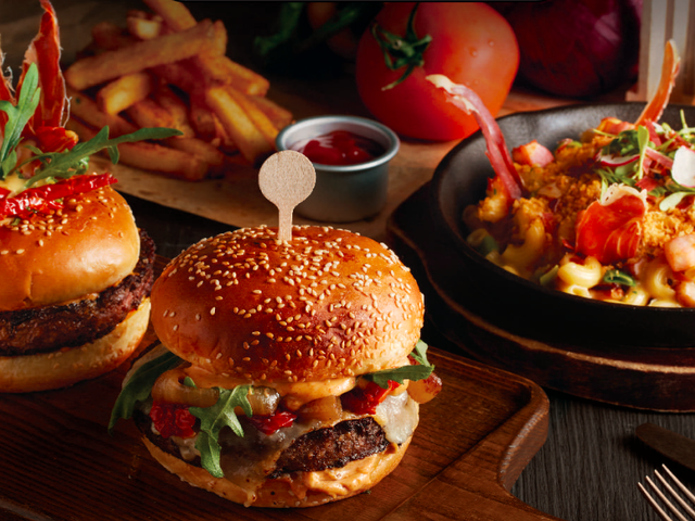 burger slider with sides served on the table