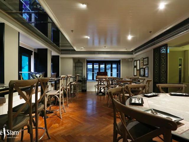 intimate dinner area with teak wood flooring
