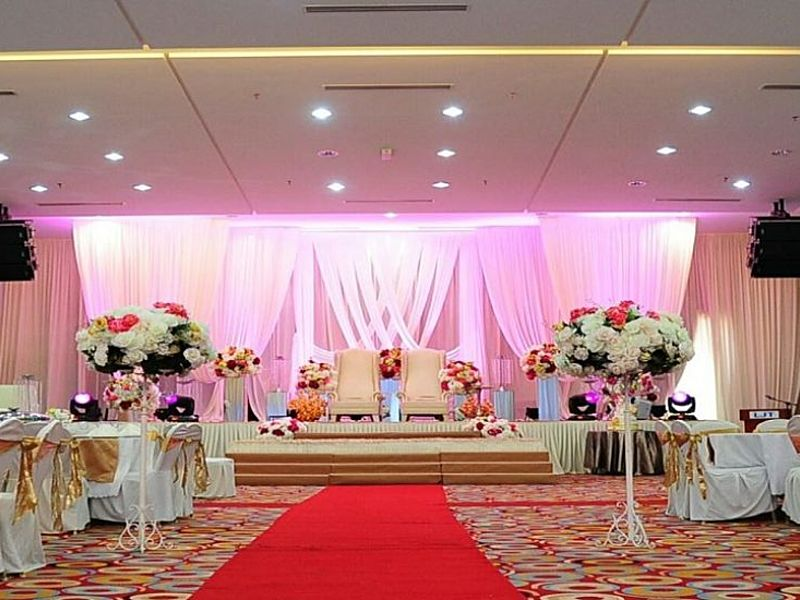 stage decoration for wedding party with flower and pink fabric