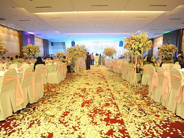 aisle for the bride and the groom decorated with flowers