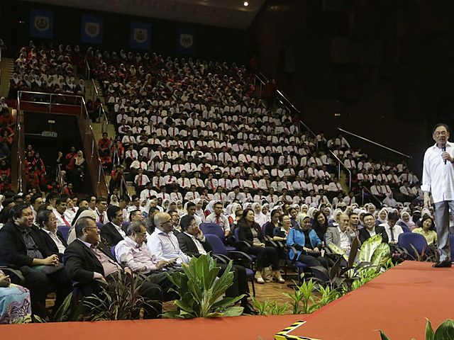 government's event with speaker on the stage of the auditorium