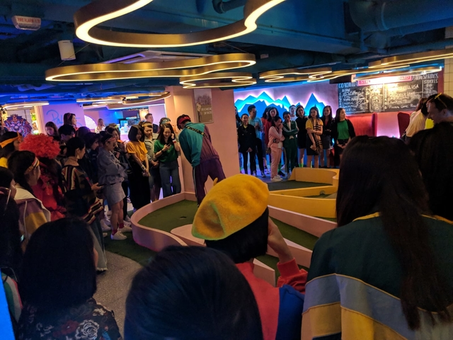 christmas party gathering in strokes mini golf bar