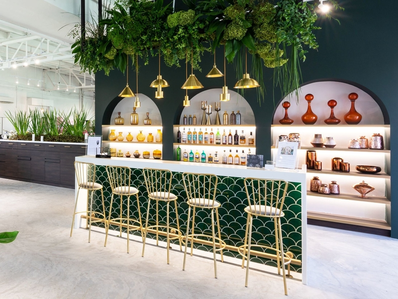 mini bar counter decorated with plants and golden pendant lamps and