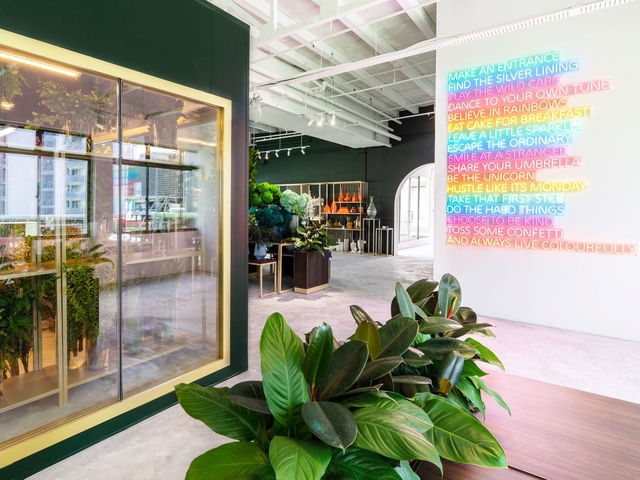 green-white event space with floral decoration and rainbow wall painting