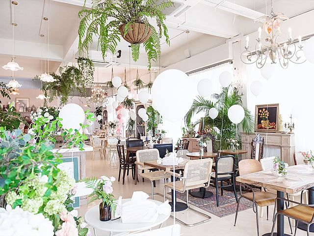 cafe with white flower and balloon theme