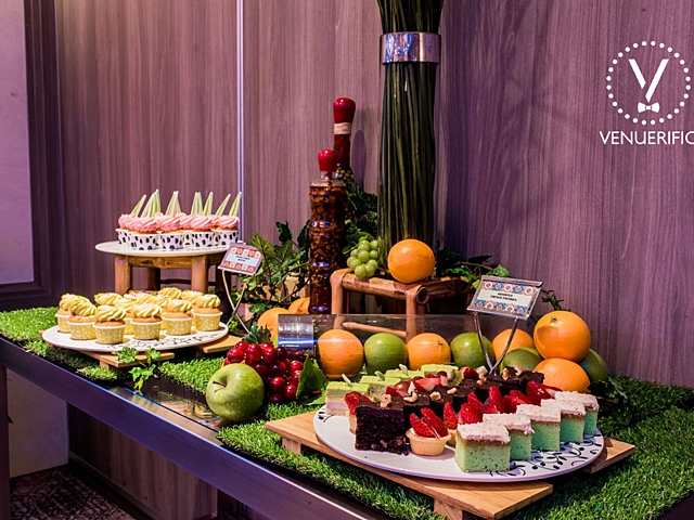 sweet desserts and fruits served on the plate