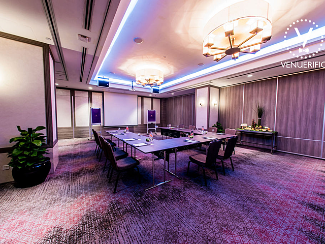 boardroom meeting setup at function room with elegant chandelier