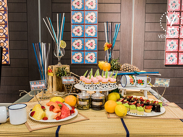 table with selection of fruits and sweet desserts