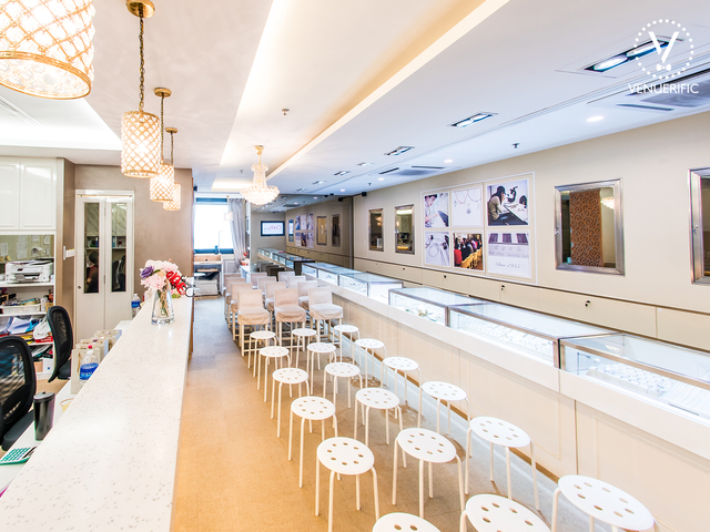 multifunctional event space with chandelier lights and spotlights