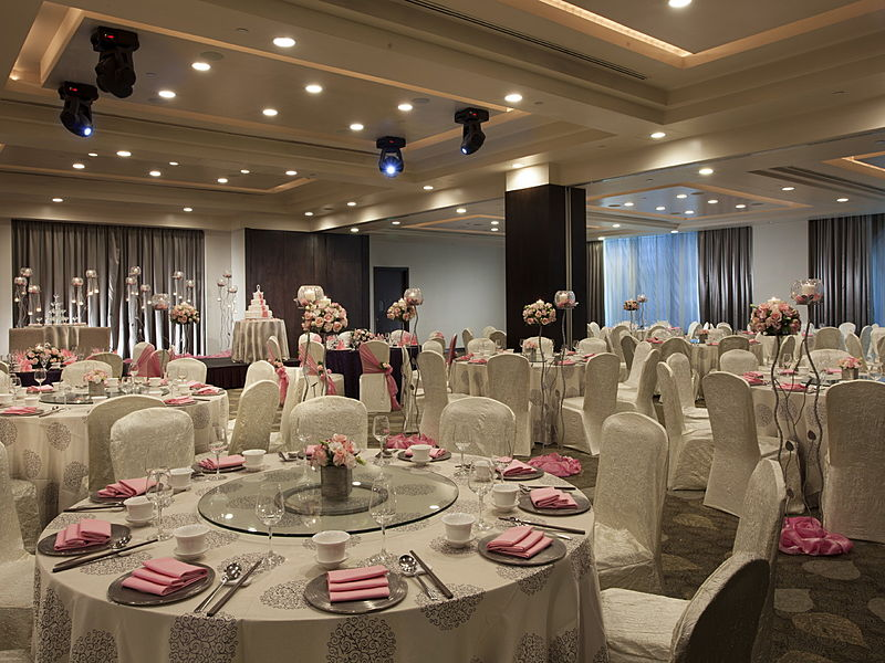 waterfront ballroom with white wedding setting and decoration