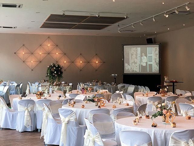 wedding decotation with round table decoration and screen projector