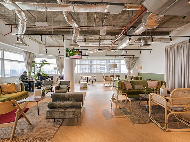 coworking lounge area with lot of sofas
