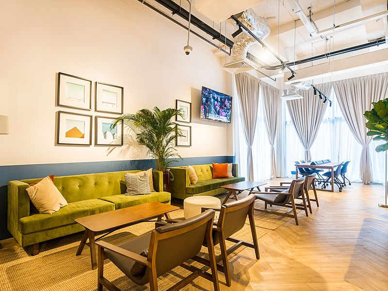 lounge area with paintings on the wall