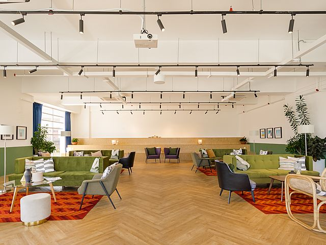 networking event space with colourful sofas
