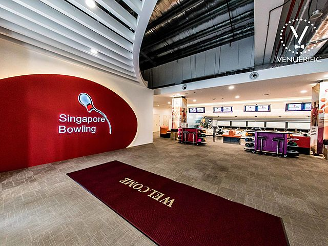 singapore bowling alley with red wallpaper and high ceiling