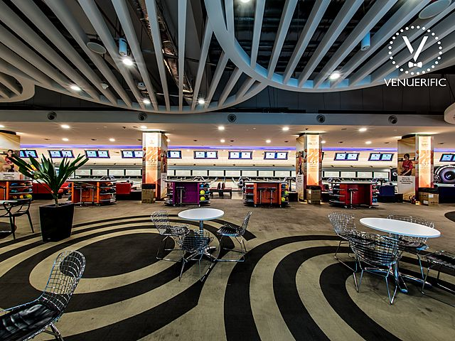 oval patterned floor in bowling alley waiting area