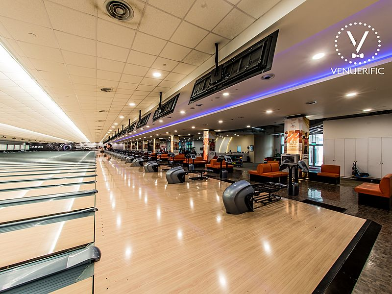 bowling alley with score screen and ball machine