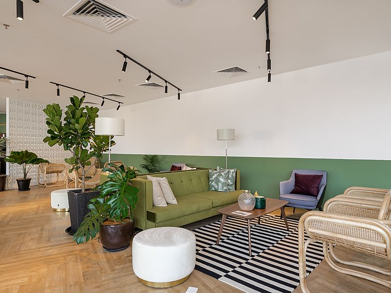 networking area with sofa and carpet