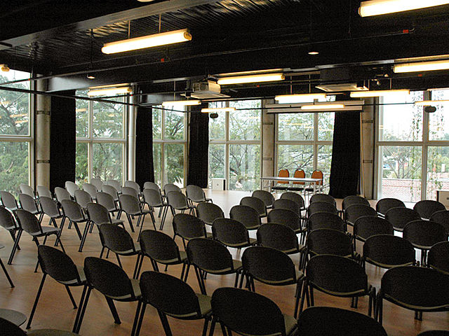 glass seminar room kuala lumpur with black audience chairs