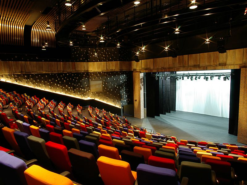 kuala lumpur theatre with a proscenium stage and colourful audience seats