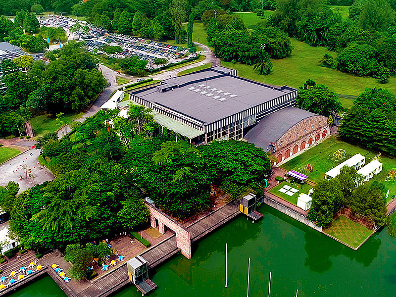 large lakeside event building in malaysia with trees surrounds