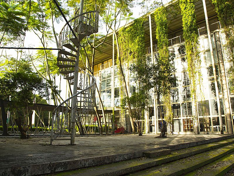 outdoor event space with spiral stairs and hanging plants