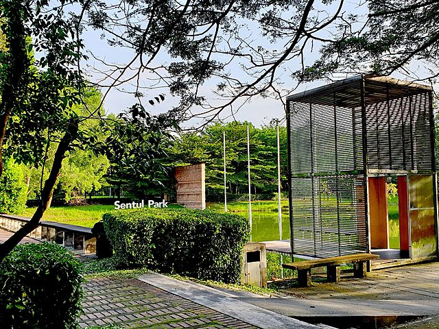 outdoor event space with garden paths and lake views in kuala lumpur