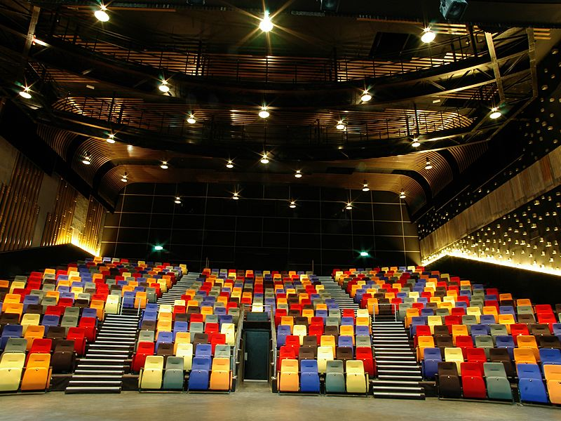 large theatre hall with colourful audience seats