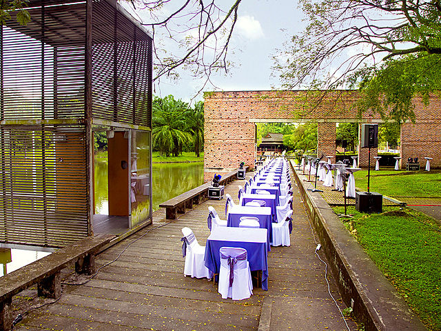 outdoor party area with river view and dining table