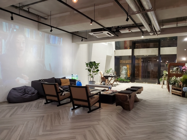 waiting area in an office with projextor screen