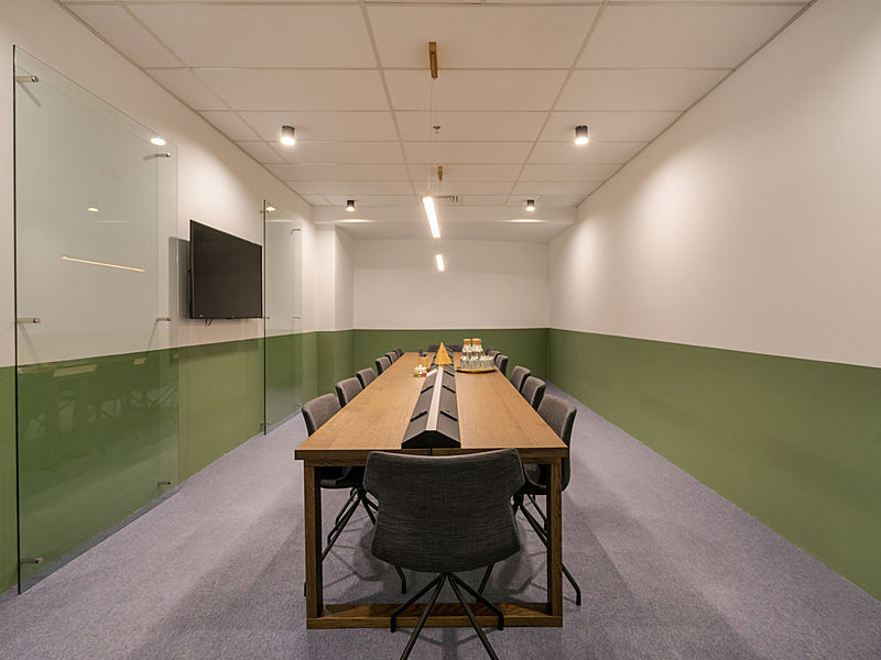 board meeting room setup with tv screen on the wall