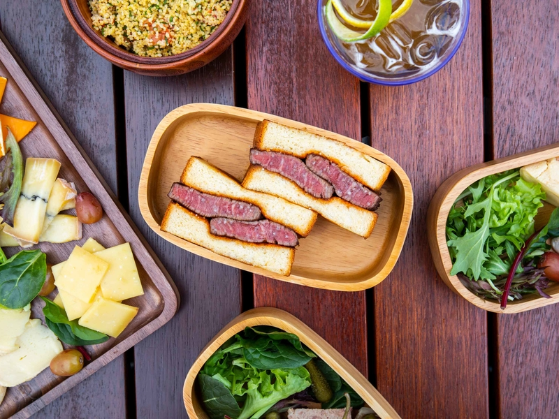 healthy sandwich and vegetables in lunch boxes