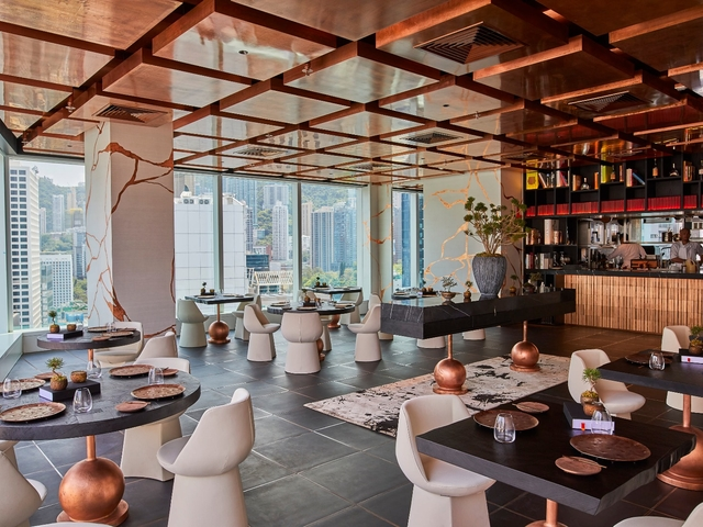 main dining area with a symmetrical copper ceiling