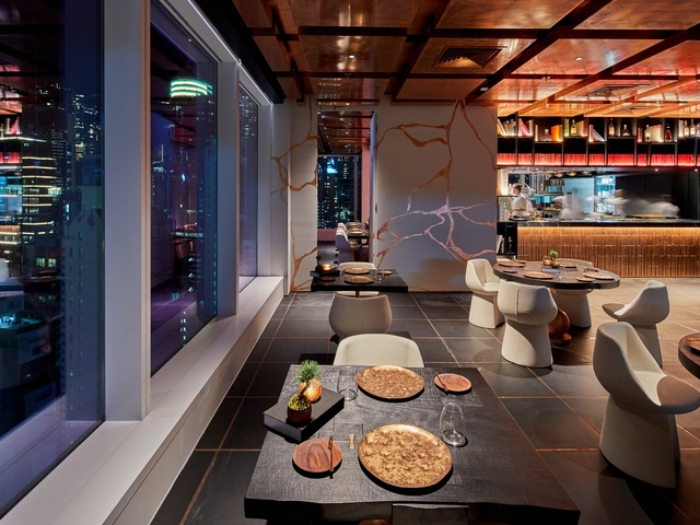 dining spot near the window with the view of hong kong