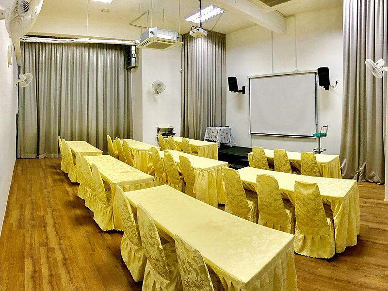 classroom seating event space in kuala lumpur with projector screen and yellow table