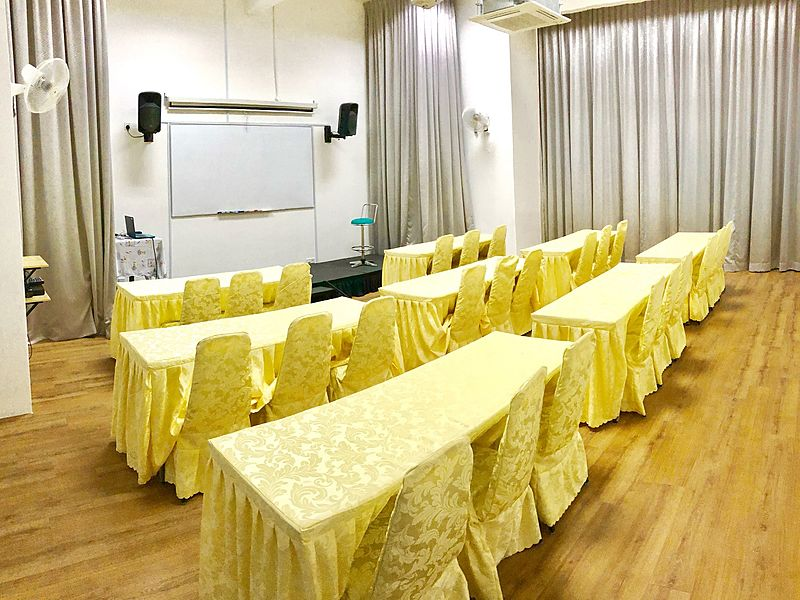 large meeting room with projector screen and speakers in kuala lumpur