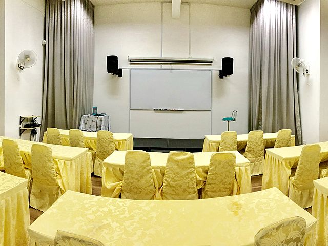 media gathering event venue in kuala lumpur with projector screen and grey drape