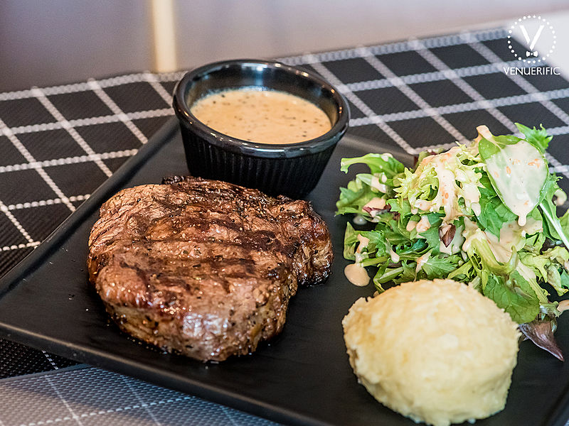 grilled angus chopped beef served with mashed potato and vegetables