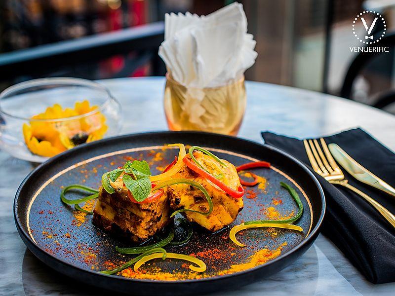 spicy chicken tikka served with garnish