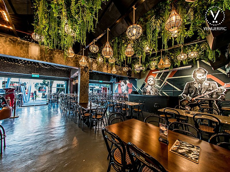 indoor indian restaurant with chandelier and hanging plants