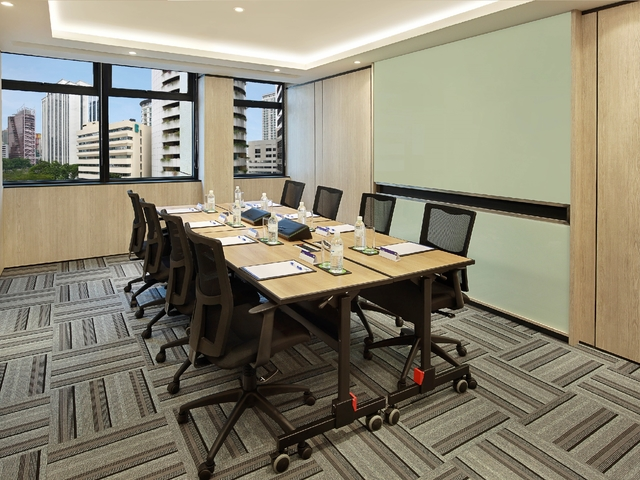 small meeting room with board and city view