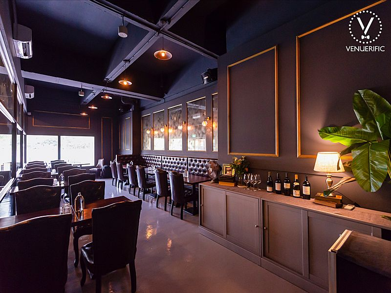 restaurant interior with black and gold dominant