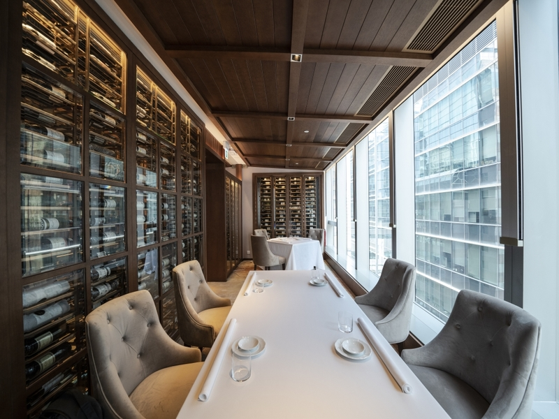 long table setup in the private room with the view of causeway bay