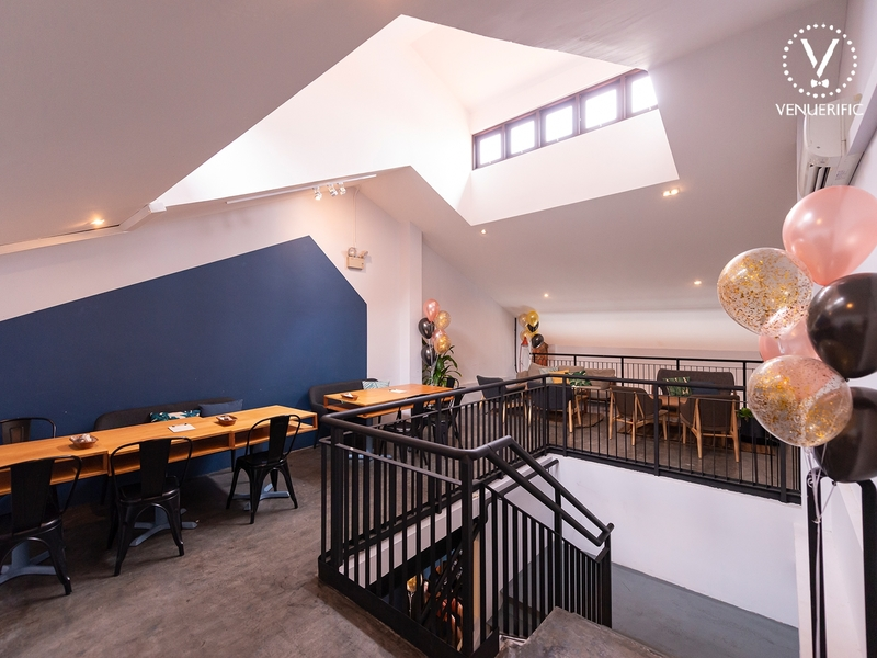second floor of restaurant with minimalist design and balloons decorations