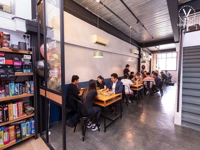 people enjoying brunch time in minimalist style restaurant with natural light