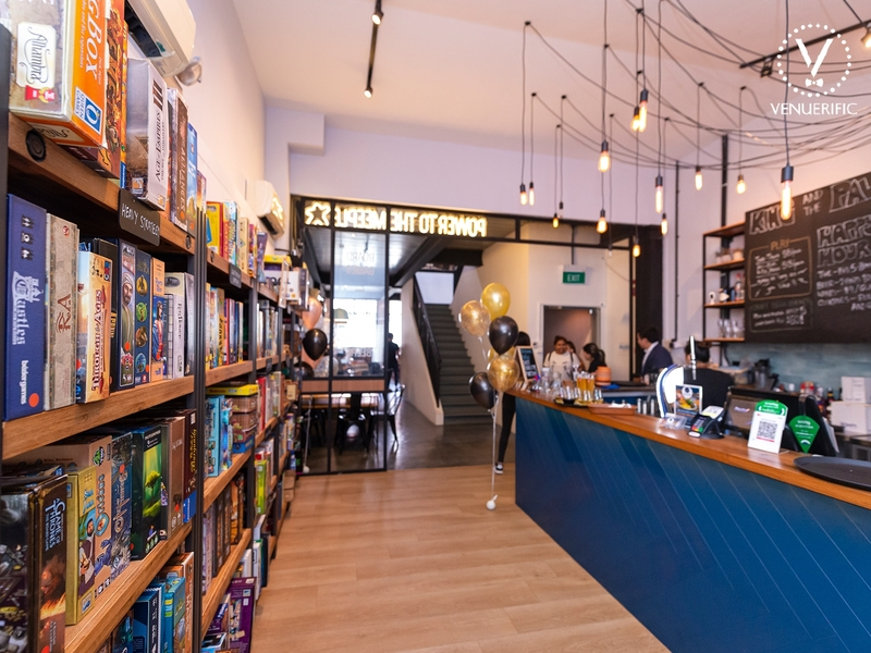 board game cafe with lot of games in the shelf
