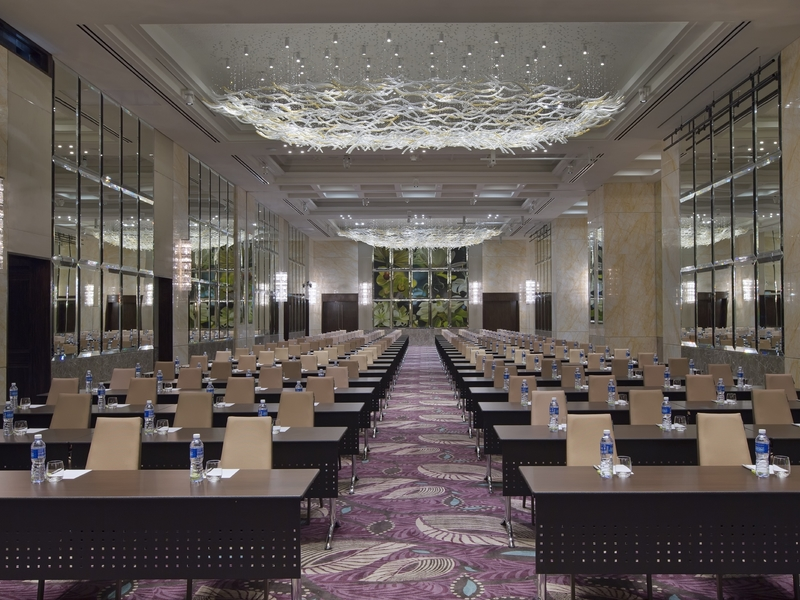 high ceiling ballroom with classroom seating and glass wall